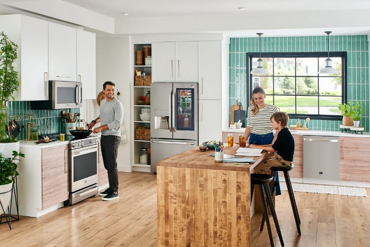 family in a kitchen with LG smart appliances