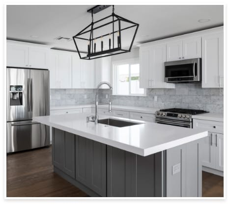 white and grey kitchen and stainless steel appliances